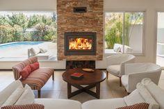 Mirá imágenes de diseños de Livings estilo moderno: Hogares insertables Nuke. Encontrá las mejores fotos para inspirarte y creá tu hogar perfecto.