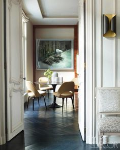 Kelli Wilde-Laurent Champeau | The table and velvet-upholstered chairs in the kitchen are Knoll, photograph is by Jeff Wall, and the Louis XVI–style side chair from Onsite Antiques is covered in a Lizzo velvet; the herringbone parquet was stained in a custom color.