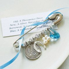 How cute is THIS?  I just stumbled upon this idea -- a bridal charm pin to pin inside a wedding gown.  Something old, something new, something borrowed, something blue!