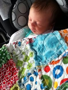 Baby Haddow tucked in with Dr Seuss rag quilt.