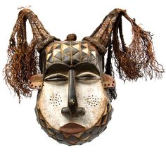 Africa | Helmet face mask from Kuba people of DR Congo | Wood, pigment, raffia | 20th century
