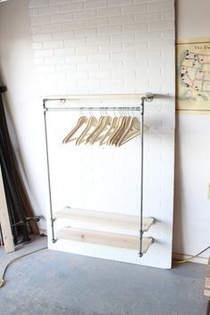 Industrial Clothing Rack / Closet Storage with 32 of hanger space and 36 shel. Industrial Clothing Rack / Closet Storage with 32 of hanger space and 36 shelves. This piece has 6 mounting brackets which are spaced 32 Small Apartment Storage, Small Closet Storage, Small Closets, Diy Storage, Storage Ideas, Storage Shelves, Baby Shelves, Small Shelves, Shelf Ideas