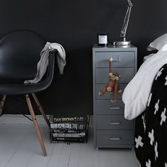 Black and white boy's bedroom with black paint color, black Eames Molded Plastic Dowel-Leg Armchair, white washed plank floors and Ikea Helmer Drawer Unit on Casters - Silver. Home Design Decor, Home Interior Design, Interior Architecture, House Design, Ikea Design, Interior Paint, Design Ideas, Decoration Inspiration, Interior Inspiration