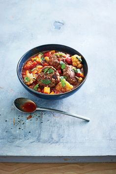 Spiced Meatball, Butternut, and Tomato Stew | MyRecipes  These tender meatballs have a mild, warm spice. Chopped cilantro at the end adds a nice burst of freshness. You can substitute ground chicken, if desired.