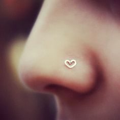 The 14K Gold Heart Online Nostril Piece is a cute dainty addition to the nose ring world.  It is so cute and small that everyone will want on of these. It is made out of 14k Gold that is very piercing friendly because it is also nickle free. This is a must have for you all you nose piercing needs. It can be worn casual or when you dress up its is totally up to you.