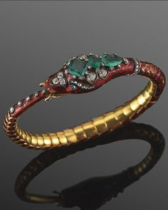 A Victorian emerald, diamond and enamel bracelet in the form of a serpent biting its tail, a symbol of eternity. (Fred Leighton)