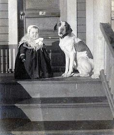 Chubby toddler (circa late 1800's - 1905) with her protective pooch.