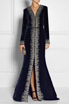 OSCAR DE LA RENTA Embellished velvet gown $12,990 Oscar de la Renta's plush velvet gown is perfect for events during the colder months. Delicate beads and crystals frame the nipped-in waist and alluring front split. Mirror the runway styling with simple sandals and drop earrings.  Shown here with: Tom Binns earrings, Alexander McQueen ring, Gianvito Rossi shoes, Bottega Veneta clutch.