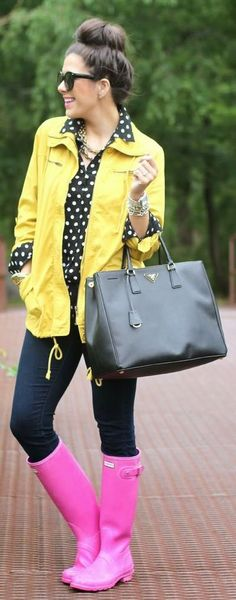 Rainy day outfit ideas. J.crew Black Silk White Dot Blouse. Skinny jeans. Hot pink rain boots. Yellow rain coat