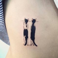 Two kitties trying to get a better look tattoo
