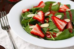 Strawberry Spinach Salad..I add sunflower seeds and purple onions with Raspberry vinigrette dressing