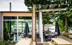 :: PODIUM CAFE :: 'Podium Cafe' - Karapiro Lakeside rustic cafe in Cambridge, NZ. World class rowing venue. Rustic Cafe, Commercial Architecture, Rowing, Cambridge, Pergola, Outdoor Structures, World, Outdoor Decor, Projects