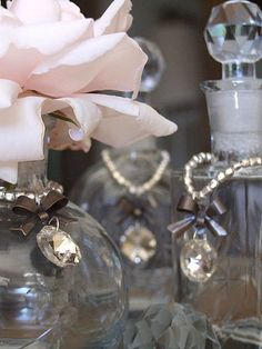 Beaded Bottle Embellishments -- these would be so easy to #DIY, and add a feminine touch to bottles on the vanity. #bath #decor