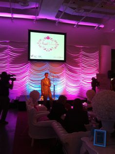 Soft draping and lights behind staging added a feminine feel to St. Laurent Centre's 2011 Royal Partea.