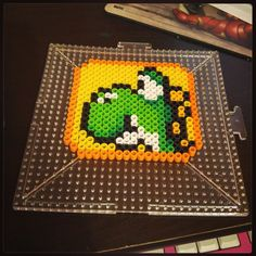 Yoshi coaster perler beads by bowtiecameraspy Perler Bead Templates, Diy Perler Beads, Pearler Beads, Fuse Beads, Pearler Bead Patterns, Perler Patterns, Yoshi, Perler Coasters, Hama Beads Design