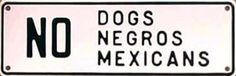 Coloured people were treated the same as animals. This sign compares dogs to coloured people in a negative way.