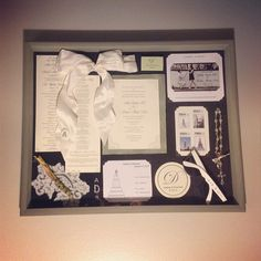 Wedding Day Shadow Box -  A great way to display all our wedding stuff!  Save the Date, Invitation, Custom Stamps, Bow and Rosary from my Bouquet, Boutonniere, Lace from my Dress, Diagram of Cake, Coaster, Sunglasses, and Matchbox       Ideas from:      http://www.thirteenacresblog.com/2011/09/thinking-inside-shadowbox.html  http://newlywedmcgees.blogspot.com/2011/08/wedding-shadow-box.html
