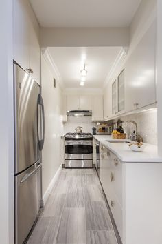 Making Way For A Nursery And More In This Duplex Apartment Renovation.  Apartment RenovationWhite Galley KitchensSmall ...