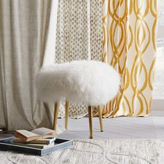 Covered in the same Mongolian lamb fur as our best-selling pillow covers, this playful stool makes a fluffy perch.