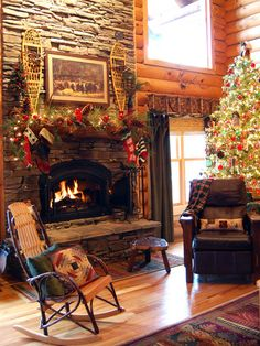 Love the stacked stone fireplace and the cozy, holiday feel of this room.