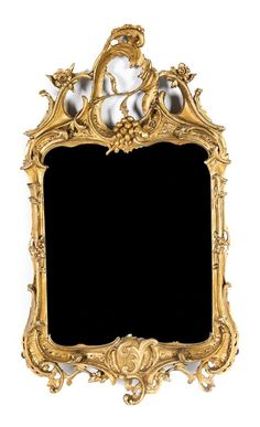 A Rococo Giltwood Mirror likely 18th century