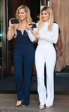 Sister act: Khloe and Kylie headed to the event with their camera phones ready...