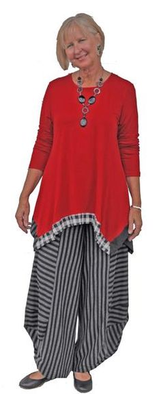 This multi fabric banded flare tunic over coordinating striped tulip pants has plenty of attitude!!!