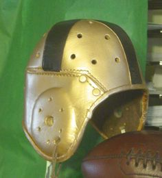 Both old Notre Dame and Army- West Point wore a Gold with a black cross leather football helmet in the 30s and 40s era