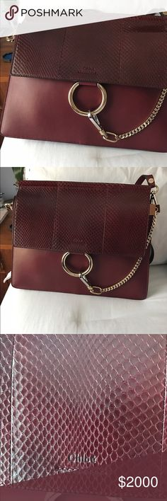 Chloe Faye snakeskin and leather shoulder bag Chloé's Faye bag is adored for its sleek, 1970s-inspired silhouette and detail. This burgundy smooth calf-leather style has a tonal snakeskin front flap that's adorned with the signature metal ring and chain detail, and opens to a well-organised interior with three useful internal pockets. Carry it alongside a ruffled blouse to stay true to the label's feminine aesthetic.  Bag retails for 2490+ taxes Chloe Bags Shoulder Bags