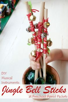 awesome DIY musical instruments...jingle bell sticks for preschool!