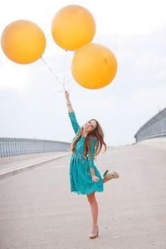round yellow balloons, green lace dress, sweet 16 photoshoot