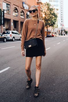 f78d792af8d45 Blonde Woman Wearing Free People Tan Sweater Black Denim Skirt Outfit Chanel  Black Boy Bag Chloe