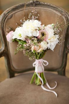 vintage wedding bouquet with ranunculus | Photo by KT Merry
