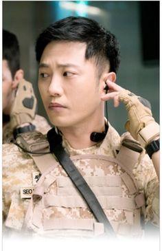 "Jin Goo ""Descendants of the Sun cast - Song Joong Ki as Captain Yoo Shi Jin of the Special Forces unit. Song Hye Kyo as Dr. Kang Mo Yeon, thoracic surgeon of a VIP ward. Kim Ji Won as. Korean Celebrities, Korean Actors, Korean Dramas, Seo Dae Young, Desendents Of The Sun, Kpop, Bh Entertainment, Song Joong Ki Birthday, Song Joon Ki"