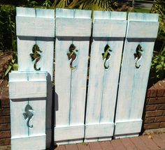 Seahorse shutters by www.CastawaysHall.etsy.com on their way to a beach house.