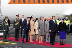 On their way: Queen Margrethe prepares to show King Willem-Alexander his Danish honour guard