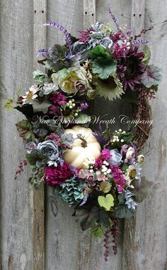 Fall Wreath, Autumn Wreath, Tuscany Wreath, XL Luxury Wreath, Fall Victorian Wreath, Sunflower Wreath, Pumpkin Wreath, Designer Fall Floral Tuscany Autumn Garden Wreath. A stunning gathering of gorgeous garden favorites in opulent hues of aubergine, deep fuchsia, purple, teal, dusty gray blue, sage green, and creamy ivory are featured in this timeless classic. An abundance of Sunflowers, Hydrangeas, Cabbage Roses, Tea Roses, Peonies, and wildflowers are featured among lush greenery, striped…