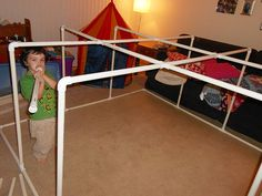 The pvc skeleton of a living room fort for the kids.  This isn't a tutorial :(  but could probably be figured out pretty easily.  The best part is that it can all be disassembled  and put away when not in use.  You could sew sheets together to cover the top and sides.  So fun!