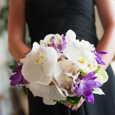 White and purple orchid bouquet | Derek Wong Photography | www.theknot.com