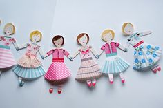 paper doll garland with cupcake liner skirts. Do this with ballerina dolls.