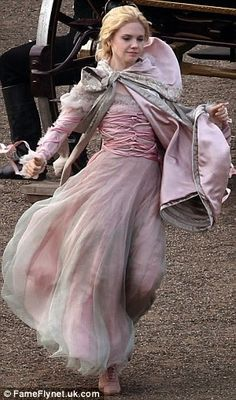 better picture - not just arm ribbons but interesting bodice wrappings too. (into the woods movie)