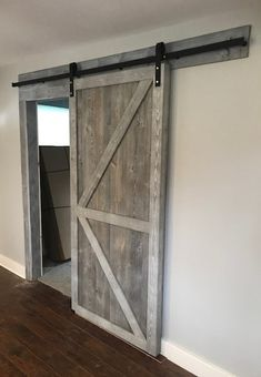 Barn door created using Easy BarnWood in Silver Ash by Great American Spaces