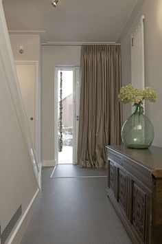 Curtain Idea 22 - Keep the warm or cool air in the house by decorating the front door with beautiful fabrics