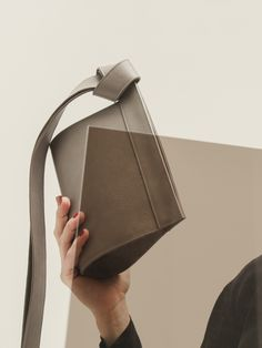 Two long leather straps, artfully knotted, grace the TAPE XS clutch bag. Its strictly geometric body forms a fascinating contrast to the softly falling straps. Clutch Bag, Tape, Natural, Grey, Womens Fashion, Leather, Collection, Gray, Duck Tape