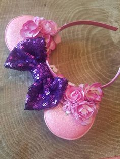 Small glitter ears that measure 3 wide with beautiful sequin bow