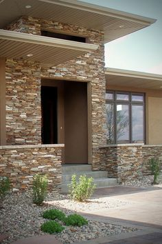 Cinnamon Bark Ledgestone veneer stone home has rich earthy real stone color tones for its stacked stone facade & cut stone masonry detail.
