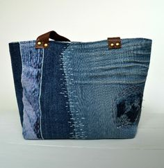 Create your own small denim tote, use up fabric scraps to make this gorgeous small bag. Free bag tutorial on the blog. Learn how to attach leather straps.