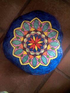 Mandala painted in rocks...This is really pretty!.. Nice job!!