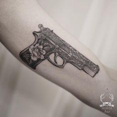 Floral gun tattoo on arm by @tattooer_intat