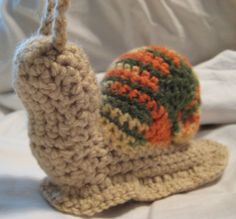 Crochet snails - My sister lives in California and has a lot of trouble with these guys eating her garden.  Think I will make these for her kids.